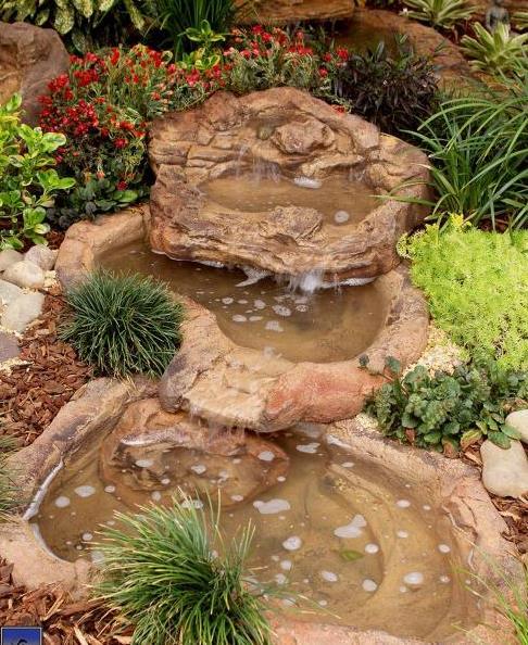 Backyard pond spillway overflow artificial ponds for Artificial pond in garden